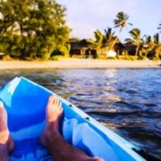 guest rumours-rarotonga-man in kayak feet returning