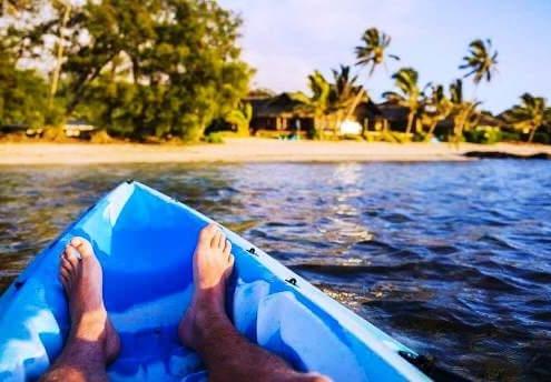 guest rumours-rarotonga-man in kayak feet returning