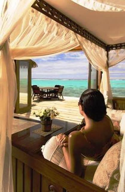 rumours woman looking towards ocean babymoons